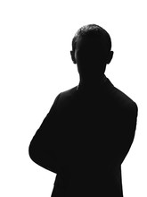 Silhouette Of A Man In A Suit Isolated On White Background