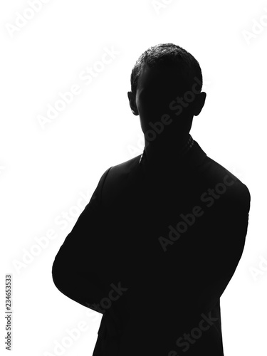 Fotomural silhouette of a man in a suit isolated on white background