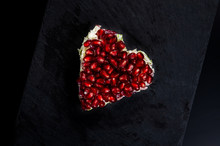 Winter Salad With Sausage, Chinese Cabbage And Pomegranate Seeds Served In The Shape Of A Heart On A Black Background, Copy Space For Your Text.