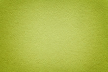 Texture Of Old Green Paper Background, Closeup. Structure Of Dense Light Olive Cardboard.