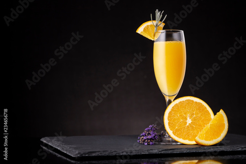 Mimosa cocktail in champagne glass