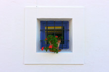 Mediterranean Traditional Architecture In Ibiza: Beatiful Small Blue Window With Flower Pot