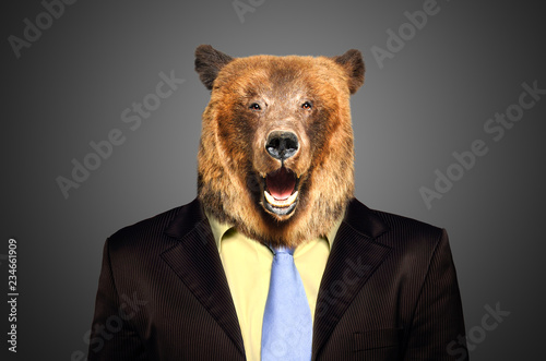Portrait of a brown bear in a business suit