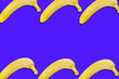 Leinwanddruck Bild - Two rows of fresh whole ripe bananas on blue background with copy space for your text