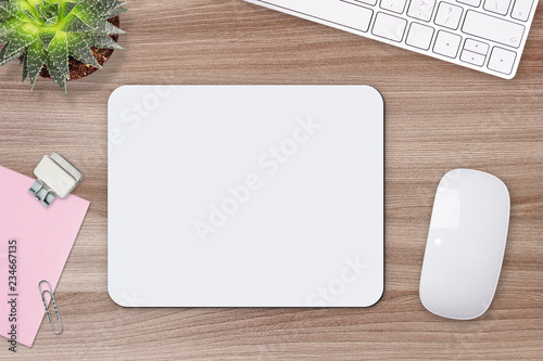Obraz Mouse pad mockup. White mat on the table with props - fototapety do salonu