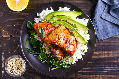 Photo sur Aluminium Poisson Salmon teriyaki rice bowl with spinach and avocado. View from above, top studio shot