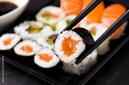 Fototapeta sushi and chopstick on sushi pack background obraz