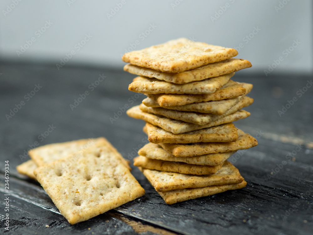 Fototapeta Crackers with cereals on a wooden table