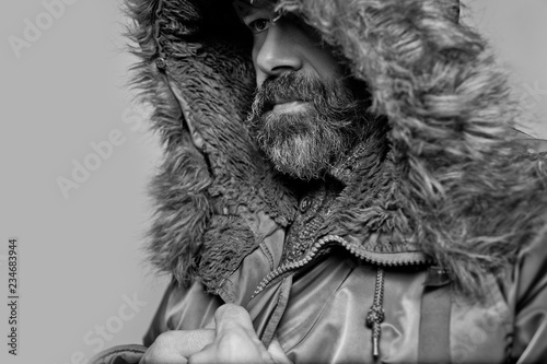 Handsome man with a beard in parka hood Canvas Print