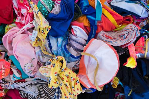 Foto op Plexiglas Paradijsvogel Summer street market store of women bikini swimsuits.