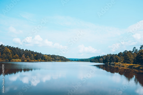 Foto op Canvas Lichtblauw landscape view of lake in sunny autumn day. sky reflection in water