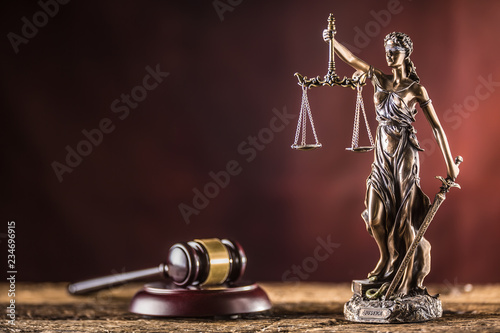 Lady Justicia holding sword and scale bronze figurine with judge hammer on woode Wallpaper Mural