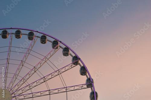 Keuken foto achterwand Amusementspark Colorful ferris wheel of the amusement park in the blue sky background.