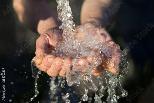 Fotografie, Obraz  hands washing with water pouring from a tap