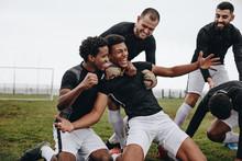 Soccer Players Doing A Knee Slide After Scoring A Goal