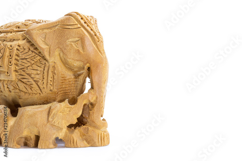 Photo Carved wooden elephant with calf, copy space