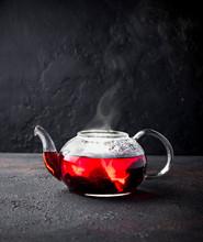 Red Hibiscus Flower Tea In Gla...