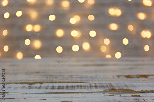 Fototapeta Selective focus. Soft yellow christmas lights with bokeh effect. Festive blurry texture background with many lit mini lamps, new year holiday decorations. Close up, copy space. obraz na płótnie