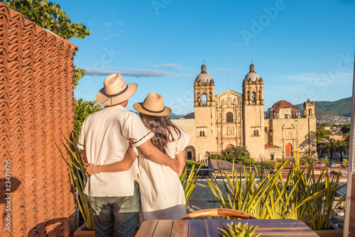 Couple contemplating the Santo Domingo Church during the sunset from a terrace i Canvas