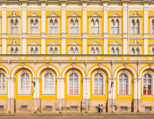Two Women Walking In The Kremlin In Front Of Grand Kremlin Palace, Moscow, Russia