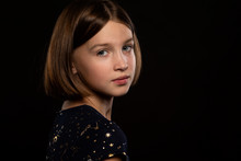 Beautiful Teen Girl With Sad Eyes, Portrait On A Black Background
