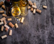 wine bottles , glass and corks on table