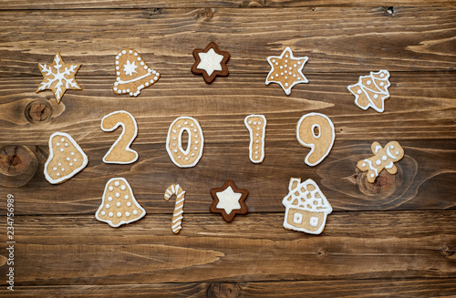 Garden Poster Cookies New Year's cookies with figures 2019 year on a wooden background