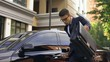 Businessman receiving good news and dancing, talking on phone near luxury car