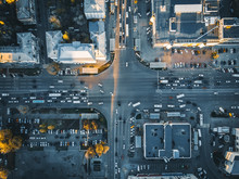 Road Traffic On Crossroad Or Intersection Downtown Of European City, Aerial Or Top View