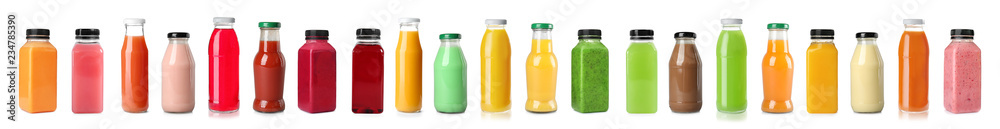 Fototapeta Set with bottles of different juices on white background