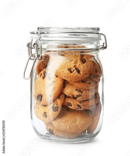 Foto Jar with tasty chocolate chip cookies on white background