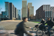 Office Buildings In Amsterdam Zuid, Amsterdam, Netherlands. People Bicycling In Amsterdam, Netherlands.