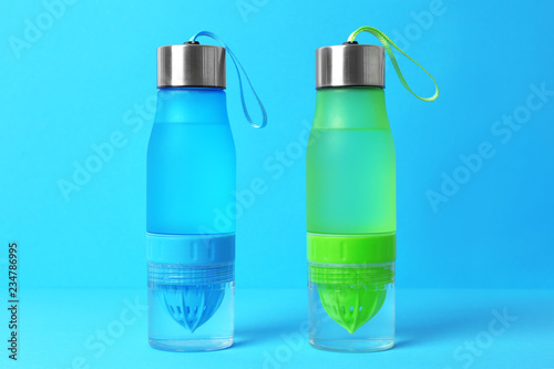 Vászonkép Sport bottles with water on color background