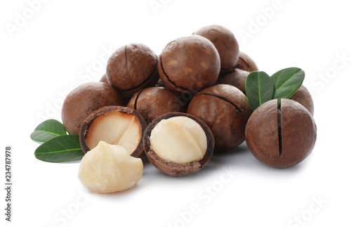Pile of organic Macadamia nuts on white background