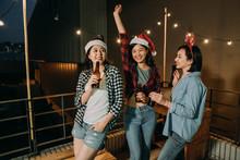 Asian Ladies Celebrating Christmas Eve On Roof