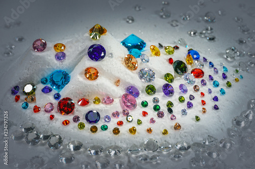 colorful diamonds on turning Showcase with snowing background. Canvas Print