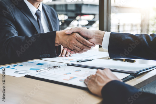 Fotografía Teamwork partnership meeting concept, Two confident Business shaking hands after