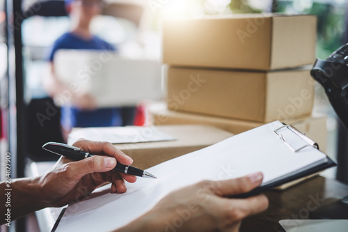 Fotografiet Home delivery service and working service mind, Woman working checking order to