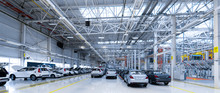 Park Cars. Building Of Automobile Plant. New Cars Are In Showroom