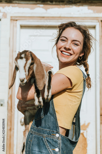 Fotografija Portrait of a beautiful young woman with a goat