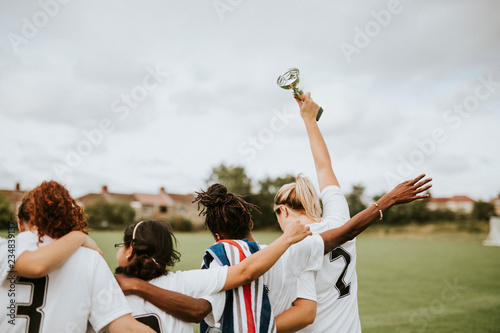 Fotomural Female football players taking a winning cup back home
