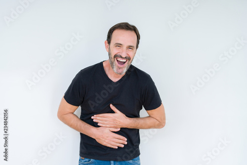 Senior man over isolated background Smiling and laughing hard out loud because funny crazy joke Fototapete