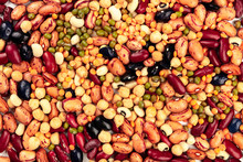 A Photo Of A Mix Of Various Types Of Legumes, Shot From The Top. Different Beans, Lentils, Chickpeas, Soybeans. An Abstract Pulses Texture