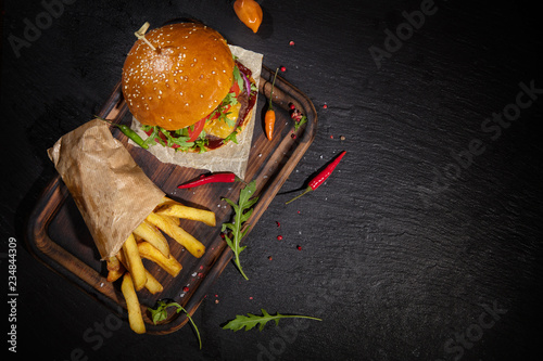 Delicious hamburger, served on stone.