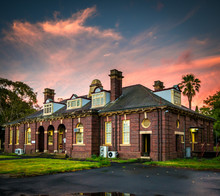 Old Victorian Edwardian Era Colonial Building.  Sunset Sky.
