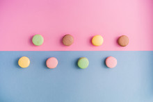 Set Of Colouful Tasty Macarons On Bright Board