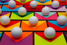 Composition With Colored Envelopes And Golf Balls On The Table.