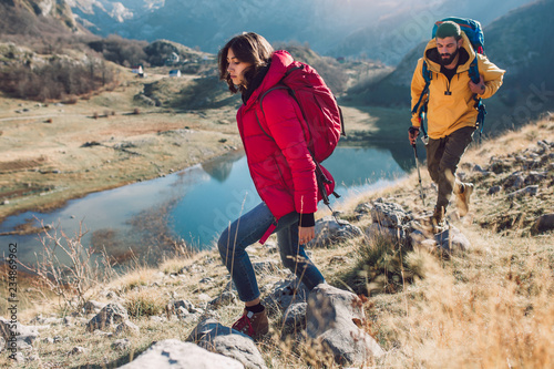 Fototapeta Group of hikers walking on a mountain at autumn day obraz