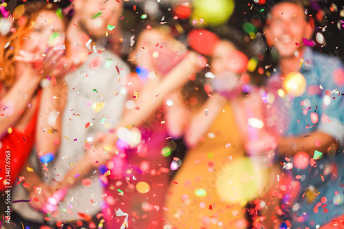Blurred people making party throwing confetti - Young people celebrating on week Tableau sur Toile