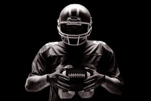 American Football Player Standing With Rugby Helmet And Ball